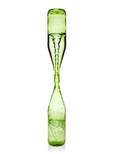 A water vortex funneling between two glass bottles